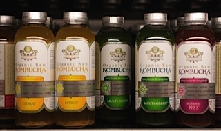 Photo of bottles of kombucha tea on a store shelf. This probiotic beverage is gluten free.