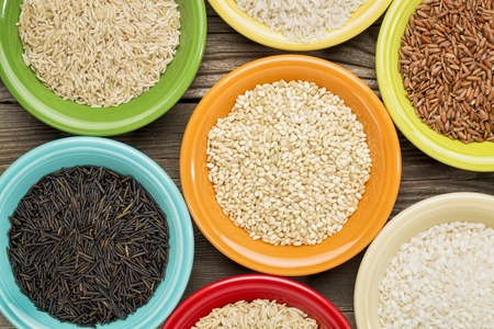 Photo of a variety of rice grains, which are traditionally considered gluten-free foods