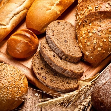 A photo of various baked breads that contain gluten