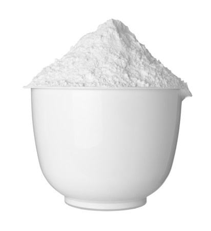 Photo of baking powder in a white bowl, which is a gluten-free additive