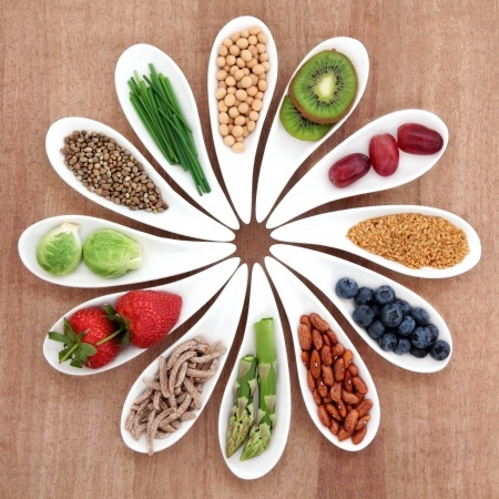 One gluten-free diet tip is to eat nutrient-dense whole foods and superfoods. The photo shows a variety of such foods.