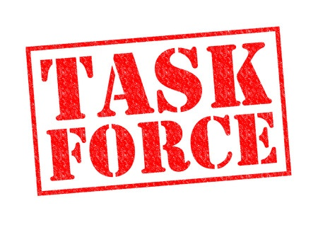 Task force rubber stamp in red letters